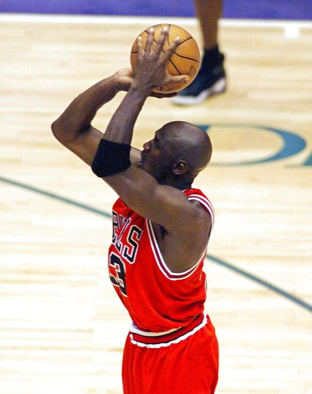 "This June 14, 1998 file photo shows Chicago Bulls guard Michael Jordan shooting the game-winning shot in the closing seconds of Game 6 of an NBA Finals basketball game against the Utah Jazz in Salt Lake City to give Chicago their sixth NBA Championship. Craig Ehlo still believes he played great defense. He shared an ultimate moment with Michael Jordan, and Jordan came out on top each time. He'll be on highlight reels forever and ""The Last Dance"" — the ESPN and Netflix 10-part documentary series about Jordan's Chicago Bulls that ends on Sunday, May 17, 2020 only freshened the familiarity fans have with two of the most-replayed shots in NBA history. (Robert Deutch/USA Today via AP, file)"