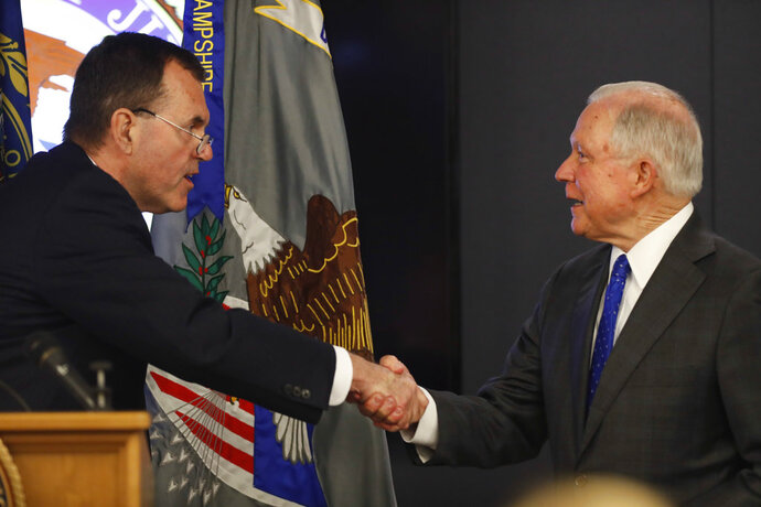 Attorney General Jeff Sessions is greeted after being introduced by Scott Murray, U.S. Attorney for New Hampshire, before speaking on the opioid and fentanyl crisis, Thursday, July 12, 2018, in Concord, N.H. (AP Photo/Robert F. Bukaty)