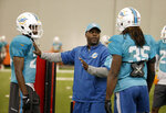 FILE - Assistant defensive backs coach Daronte Jones, center, talks with safety Isa Abdul-Quddus, left, and free safety Walt Aikens (35), during an NFL football practice in Davie, Fla., in this Wednesday, Aug. 17, 2016, file photo. Daronte Jones is the new defensive coordinator for the LSU NCAA college football team. Jones had an introductory media conference on Tuesday, Feb. 2, 2021. (AP Photo/Lynne Sladky, FIle)