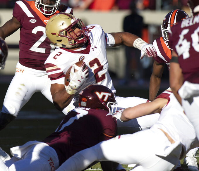 Boston College running back AJ Dillion is brought down  during the first half of an NCAA college football game against Virginia Tech in Blacksburg, Va., Saturday, Nov. 3, 2018. (AP Photo/Matt Bell)