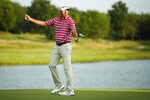 Jim Herman celebrates after winning the PGA Barbasol Championship gold tournament at Keene Trace Golf Club's Champions Course in Nicholasville, Ky., Sunday, July 21, 2019. (Alex Slitz/Lexington Herald-Leader via AP)