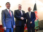 US Secretary of State Mike Pompeo, center, shakes hands with Afghan President Ashraf Ghani, right, as US Secretary of Defense Mark Esper watches during the 56th Munich Security Conference (MSC) in Munich, southern Germany, on Friday, Feb. 14, 2020. The 2020 edition of the Munich Security Conference (MSC) takes place from Feb. 14 to 16. (Andrew Caballero-Reynolds/Pool photo via AP)