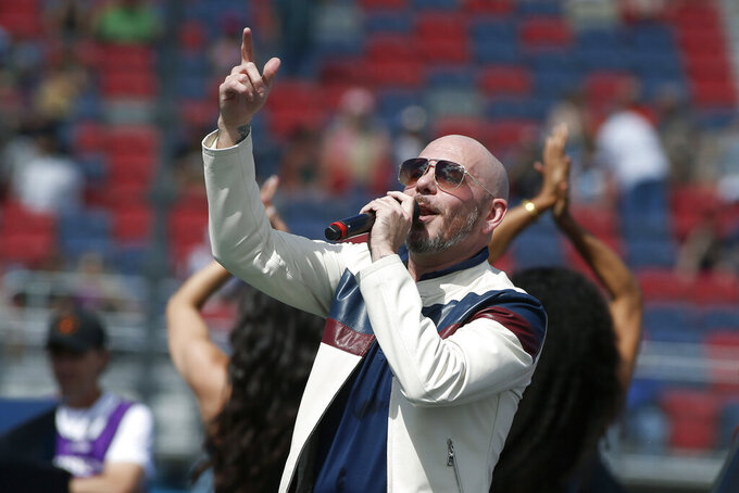 "FILE - Pitbull performs prior to a NASCAR Cup Series auto race at Phoenix Raceway in Avondale Ariz., in this Sunday, March 8, 2020, file photo. New NASCAR team Trackhouse Racing has brought entertainer Pitbull on as an ownership partner for an organization making its debut next month at the Daytona 500.  ""Mr. Worldwide"" joins NBA Hall of Famer Michael Jordan as celebrity owners entering NASCAR this year. (AP Photo/Ralph Freso, File)"