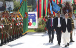 In this photo released by the Afghan Presidential Palace, Afghan President Ashraf Ghani, right, inspects the guard of honor during Independence Day celebrations at Defense Ministry in Kabul, Afghanistan, Monday, Aug. 19, 2019. Afghanistan's president is vowing to eliminate all safe havens of the Islamic State group as the country marks a subdued 100th Independence Day after a horrific wedding attack claimed by the local IS affiliate. (Afghan Presidential Palace via AP)