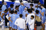 North Carolina head coach Roy Williams, center, talks with his team during the first half of an NCAA college basketball game in the quarterfinal round of the Atlantic Coast Conference tournament in Greensboro, N.C., Thursday, March 11, 2021. (AP Photo/Gerry Broome)
