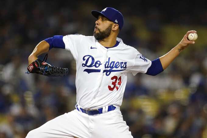 Los Angeles Dodgers relief pitcher David Price throws to an Arizona Diamondbacks batter during the sixth inning of a baseball game Tuesday, Sept. 14, 2021, in Los Angeles. (AP Photo/Marcio Jose Sanchez)