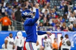 New York Giants kicker Graham Gano celebrates after kicking the point after try during the first half of an NFL preseason football game against the New England Patriots Sunday, Aug. 29, 2021, in East Rutherford, N.J. (AP Photo/John Minchillo)