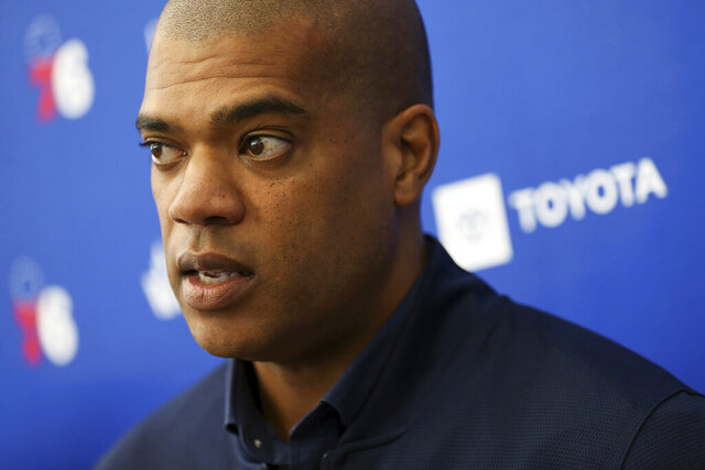 FILE - In this June 13, 2019, file photo, Philadelphia 76ers NBA basketball team executive Marc Eversley smiles while talking to reporters during a pre-draft workout at the Sixers Training Complex in Camden, N.J. New Chicago Bulls general manager Marc Eversley addresses the media for the first time since he was hired this week to replace the fired Gar Forman. Eversley -- who will work under new executive vice president of basketball operations -- becomes the franchise's first black GM after four seasons in Philadelphia's front office.  (Tim Tai/The Philadelphia Inquirer via AP, File)