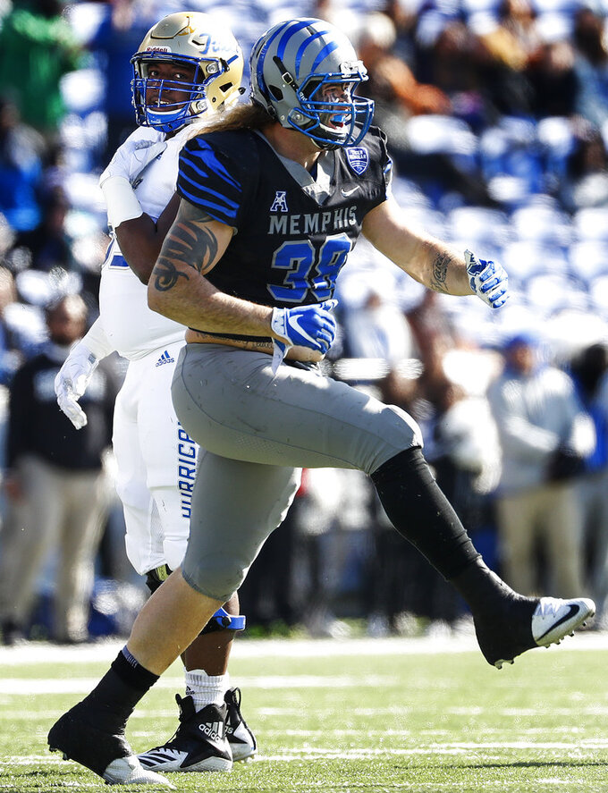 Memphis defender Jonathan Wilson celebrates a sack against Tulsa during an NCAA college football game in Memphis, Tenn., Saturday, Nov. 10, 2018. (Mark Weber/The Commercial Appeal via AP)
