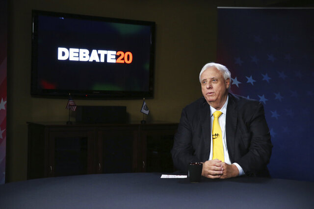 West Virginia Gov. Jim Justice prepares for a debate with Democratic challenger, Kanawha County Commissioner Ben Salango, Tuesday Oct. 13. 2020, in Morgantown, W.Va. (AP Photo/Kathy Batten)