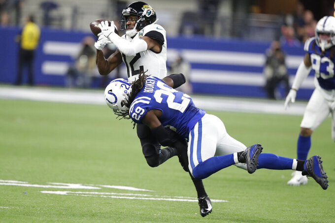 Jacksonville Jaguars' Dede Westbrook (12) cannot hang onto a catch as he his hit by Indianapolis Colts' Malik Hooker (29) during the second half of an NFL football game, Sunday, Nov. 17, 2019, in Indianapolis. (AP Photo/Michael Conroy)