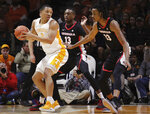 Tennessee forward Grant Williams (2) looks for the shot while Georgia forward E'Torrion Wildrige (13) and Nicolas Claxton (33) defend in the first half of an NCAA college basketball game Saturday, Jan. 5, 2019, in Knoxville, Tenn. (AP Photo/Shawn Millsaps)