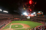 FILE - In this July 11, 1995, file photo, the National League celebrates with fireworks following Tuesday night's All-Star Game at The Ballpark in Arlington in Arlington, Texas. Before moving across the street next season into a $1 billion-plus air-conditioned stadium with a retractable roof, the Rangers have three games this week against the Boston Red Sox and then end the season with three games against the AL East champion New York Yankees. (AP Photo/Pat Sullivan, File)