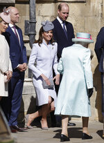 Britain's Kate, The Duchess of Cambridge curtsies as Britain's Queen Elizabeth II arrives to attend the Easter Mattins Service at St. George's Chapel, at Windsor Castle in England Sunday, April 21, 2019. (AP Photo/Kirsty Wigglesworth, pool)