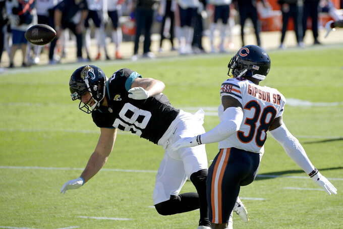 Chicago Bears safety Tashaun Gipson Sr. (38) breaks up a pass intended for Jacksonville Jaguars tight end Tyler Eifert., left, during the first half of an NFL football game, Sunday, Dec. 27, 2020, in Jacksonville, Fla. (AP Photo/Phelan M. Ebenhack)