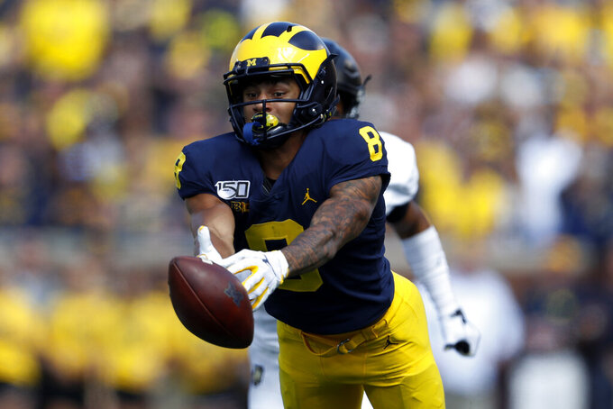 Michigan wide receiver Ronnie Bell (8) reaches but can't catch a Shea Patterson pass in the first half of an NCAA college football game against Army in Ann Arbor, Mich., Saturday, Sept. 7, 2019. (AP Photo/Paul Sancya)