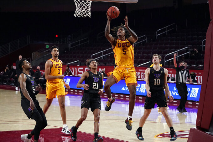Southern California guard Isaiah White (5) scores against Washington during the second half of an NCAA college basketball game Thursday, Jan. 14, 2021, in Los Angeles. (AP Photo/Marcio Jose Sanchez)