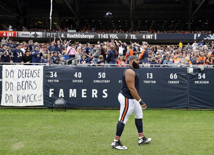 FILE - In this Sunday, Sept. 30, 2018, file photo,  Chicago Bears defensive end Akiem Hicks (96) leaves the field after being ejected during the first half of an NFL football game against the Tampa Bay Buccaneers in Chicago. Hicks is relieved to draw a $33,425 fine while avoiding a suspension, after he was ejected for contact with an official during a shoving incident following a turnover against Tampa Bay. (AP Photo/Nam Y. Huhm File)