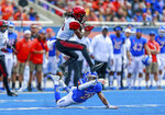 San Diego State wide receiver BJ Busbee, in the air, avoids the tackle attempt by Boise State safety Tyreque Jones, on the ground, in the first half of an NCAA college football game, Saturday, Oct. 6, 2018, in Boise, Idaho. (AP Photo/Steve Conner)
