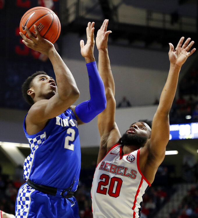 Kentucky guard Ashton Hagans (2) shoots next to Mississippi guard D.C. Davis (20) during the second half of an NCAA college basketball game in Oxford, Miss., Tuesday, March 5, 2019. Kentucky won 80-76. (AP Photo/Rogelio V. Solis)