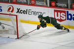 Minnesota Wild center Nico Sturm makes a wraparound shot for goal against the San Jose Sharks during the second period of an NHL hockey game Saturday, April 17, 2021, in St. Paul, Minn. (AP Photo/Craig Lassig)