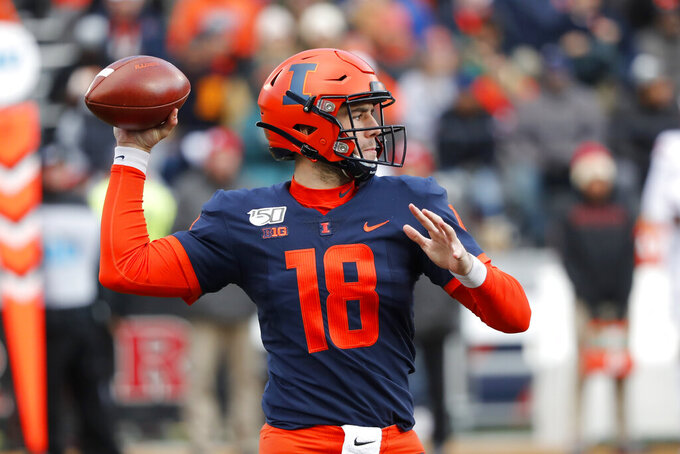 Illinois quarterback Brandon Peters passes during the first half of an NCAA college football game against Rutgers, Saturday, Nov. 2, 2019, in Champaign, Ill. (AP Photo/Charles Rex Arbogast)