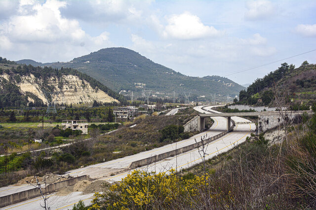 This Tuesday, March. 10, 2020 photo, released by the Syrian official news agency SANA, shows the road that links Syria's coastal region with the northern city of Aleppo, in Latakia province, Syria. The reopening of the M4 highway that has been closed since 2012 is part of a deal reached earlier this month between Turkey and Russia that stopped a Russian-backed government offensive on the northwestern province of Idlib, the last rebel stronghold in the country. (SANA via AP)