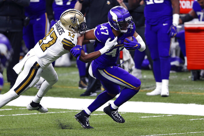 Minnesota Vikings middle linebacker Hardy Nickerson (47) returns an interception on a pass intended for New Orleans Saints wide receiver Emmanuel Sanders (17) in the second half of an NFL football game in New Orleans, Friday, Dec. 25, 2020. (AP Photo/Butch Dill)