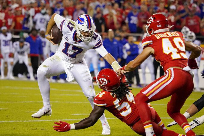 Buffalo Bills quarterback Josh Allen (17) runs with the ball as Kansas City Chiefs linebacker Nick Bolton (54) and safety Daniel Sorensen (49) defend during the first half of an NFL football game Sunday, Oct. 10, 2021, in Kansas City, Mo. (AP Photo/Ed Zurga)