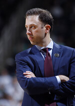 Minnesota coach Richard Pitino watches during the first half of an NCAA college basketball game against Michigan State, Saturday, Feb. 9, 2019, in East Lansing, Mich. Michigan State won 79-55. (AP Photo/Al Goldis)