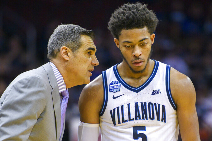 Villanova head coach Jay Wright confers with guard Justin Moore (5) during the second half of the Never Forget Tribute Classic NCAA college basketball game against Delaware, Saturday, Dec. 14, 2019, in Newark, N.J. (AP Photo/Corey Sipkin)