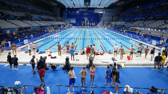 Athletes exercise during a swimming training session at the Tokyo Aquatics Centre at the 2020 Summer Olympics, Friday, July 23, 2021, in Tokyo, Japan. (AP Photo/Martin Meissner)