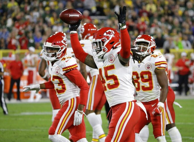 Kansas City Chiefs' D'Juan Hines reacts after recovering a fumble during the second half of a preseason NFL football game against the Green Bay Packers Thursday, Aug. 29, 2019, in Green Bay, Wis. (AP Photo/Mike Roemer)