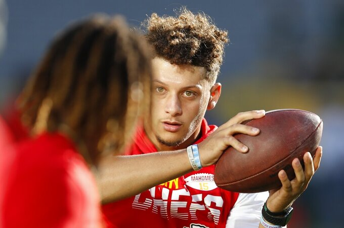 Kansas City Chiefs quarterback Patrick Mahomes warms up before a preseason NFL football game against the Green Bay Packers Thursday, Aug. 29, 2019, in Green Bay, Wis. (AP Photo/Matt Ludtke)