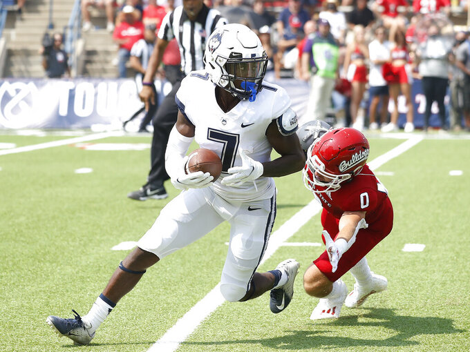 Connecticut wide receiver Cameron Ross (7) runs past Fresno State's Evan Bennett during the first half of an NCAA college football game in Fresno, Calif., Saturday, Aug. 28, 2021. (AP Photo/Gary Kazanjian)