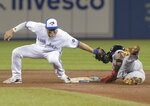 Boston Red Sox' Eduardo Nunez beats the tag attempt by Toronto Blue Jays' Aledmys Diaz to steal second base during the fifth inning of a baseball game Thursday, Aug. 9, 2018, in Toronto. (Fred Thornhill/The Canadian Press via AP)