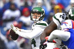 FILE - In this Dec. 29, 2019, file photo, New York Jets quarterback Sam Darnold (14) throws a pass during the first half of an NFL football game against the Buffalo Bills in Orchard Park, N.Y. Darnold was mostly pleased with how he finished last year with the New York Jets. The young quarterback enters his third NFL season knowing he needs to be even better. (AP Photo/Adrian Kraus, File)