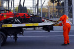 The car of Ferrari driver Charles Leclerc of Monaco is towed after he crashed during qualifying session at the Baku Formula One city circuit in Baku, Azerbaijan, Saturday, April 27, 2019. The Azerbaijan F1 Grand Prix race will be held on Sunday. (AP Photo/Sergei Grits)