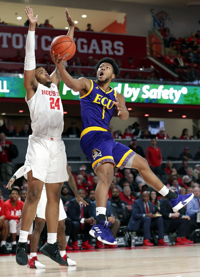 East Carolina forward Jayden Gardner (1) puts up a shot past Houston forward Breaon Brady (24) during the first half of an NCAA college basketball game Wednesday, Jan. 23, 2019, in Houston. (AP Photo/Michael Wyke)