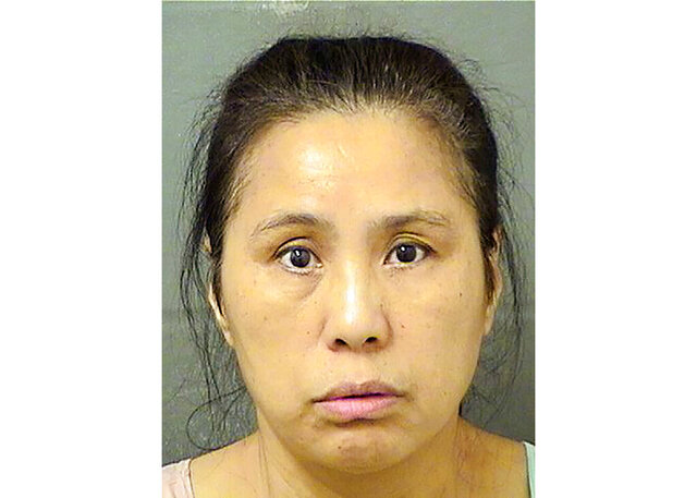 FILE - This Wednesday, Dec. 18, 2019, file booking photo provided by the Palm Beach County Sheriff's Office, in Fla., shows Jing Lu.  A Florida jury on Wednesday, Feb. 12, 2019 found Jing Lu, a 56-year-old Chinese woman, not guilty of trespassing at President Donald Trump's part time residence in Palm Beach. Jurors did find Jing Lu guilty of resisting a police officer without violence during her arrest. The incident marked the second time in 2019 that a Chinese national was charged with illicitly entering Trump's Florida resort. (Palm Beach County Sheriff's Office via AP, File)