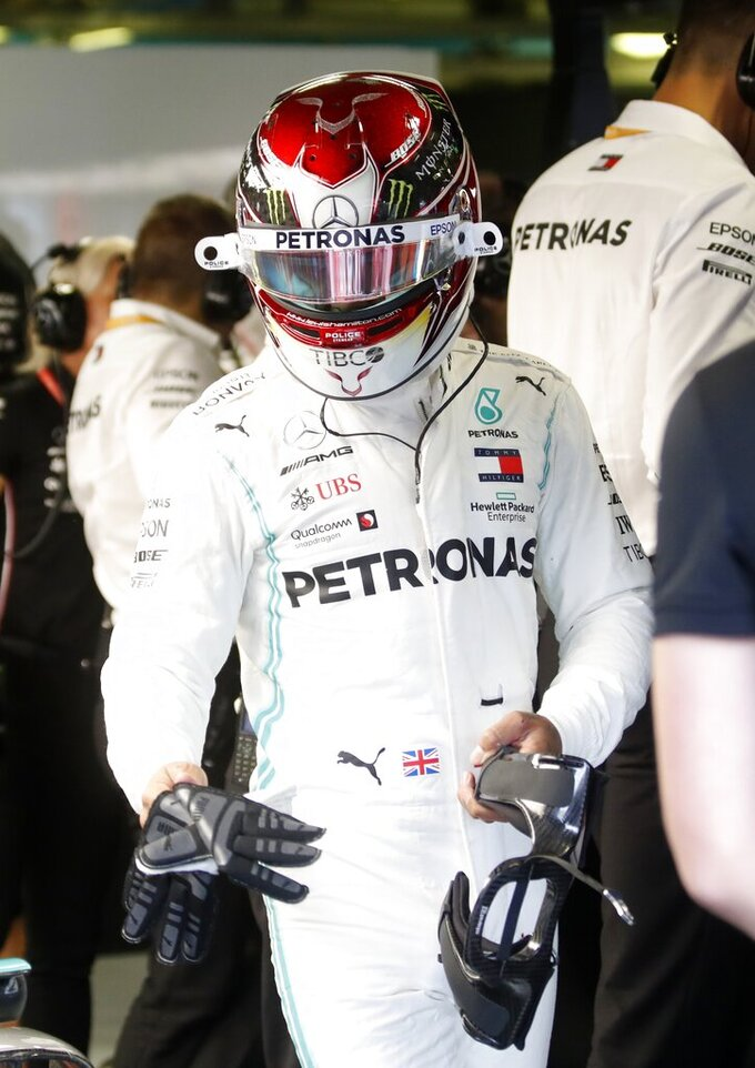 Mercedes driver Lewis Hamilton of Britain prepares to get in his car at the pits during the first free practice at the Monza racetrack, in Monza, Italy, Friday, Sept. 6, 2019. The Formula one race will be held on Sunday. (AP Photo/Antonio Calanni)