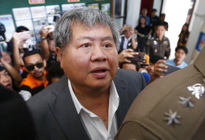 Thai business tycoon president of Italian-Thai Development Premchai Karnasuta arrives at the wildlife police headquarters Bangkok, Thailand, Wednesday, March 14, 2018. Premchai, currently facing nine charges including illegal hunting in a wildlife sanctuary, was further charged with illegal possession of ivory, illegal possession of firearms and attempted bribery. (AP Photo/Sakchai Lalit)