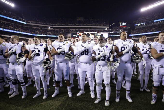 Navy Midshipmen stand for their song after an NCAA college football game against Army, Saturday, Dec. 8, 2018, in Philadelphia. Army won 17 -10. (AP Photo/Matt Rourke)