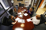 Jo Trizila, top right, President and CEO of Trizcom Public Relations, conducts a meeting with her staff Ann Littmann, right, Noel Hampton, bottom left, and Hayley Swinton at their office in Dallas, Tuesday, Jan. 21, 2020. The recent flu outbreak can really impact small businesses with small staffs and hurt a company's productivity. Some owners, like Trizila, are trying to mitigate the damage so the flu will not become a nightmare when they're trying to get clients' work done. (AP Photo/LM Otero)