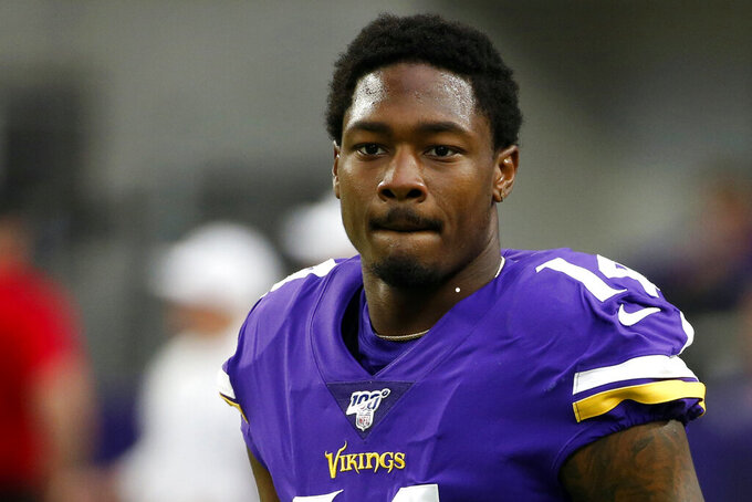 FILE - In this Sept. 22, 2019, file photo, Minnesota Vikings wide receiver Stefon Diggs walks on the field before an NFL football game against the Oakland Raiders in Minneapolis. Diggs is expected to address reporters Wednesday, Aug. 5, 2020, during the team's first full week of the Buffalo Bills' training camp, and for the first time since being acquired in a trade with the Vikings in March .(AP Photo/Bruce Kluckhohn, File)