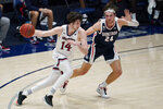 Saint Mary's forward Kyle Bowen (14) drives against Gonzaga forward Corey Kispert (24) during the first half of an NCAA college basketball game in Moraga, Calif., Saturday, Jan. 16, 2021. (AP Photo/Jeff Chiu)