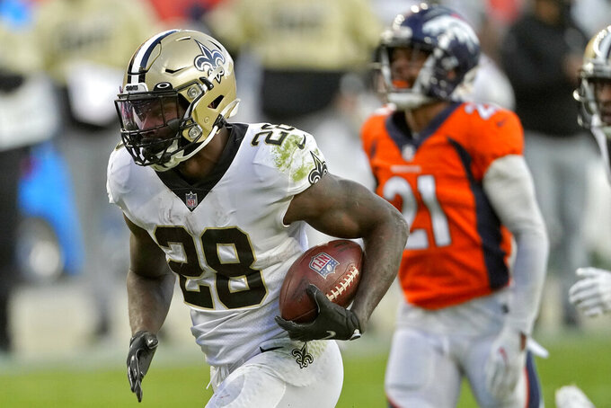 New Orleans Saints running back Latavius Murray (28) runs for a touchdown as Denver Broncos cornerback A.J. Bouye (21) pursues during the second half of an NFL football game, Sunday, Nov. 29, 2020, in Denver. (AP Photo/Jack Dempsey)