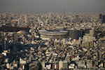 FILE - In this Monday, Jan. 20, 2020, file photo, New National Stadium, center, a venue for the opening and closing ceremonies at the Tokyo 2020 Olympics, is seen from Shibuya Sky observation deck in Tokyo. The Tokyo Olympics open exactly six months from Friday, Jan. 24, 2020 and the United States and China are picked to finish 1-2 in the overall medal count and the gold-medal count. That's the easy part in a forecast done by Gracenote Sports about which countries will win the most Olympic medals. Gracenote supplies analysis for leagues around the world and has a solid track record forecasting recent Olympics. (AP Photo/Jae C. Hong, File)