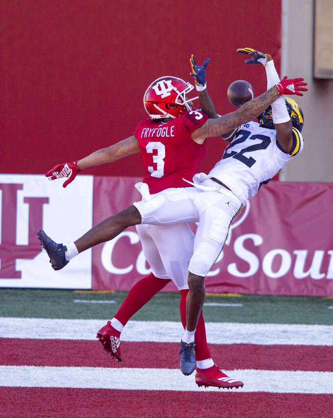 Indiana wide receiver Ty Fryfogle (3) and Michigan defensive back Gemon Green (22) battle for a pass in the end zone during the second half of an NCAA college football game Saturday, Nov. 7, 2020, in Bloomington, Ind. Indiana won 38-21. (AP Photo/Doug McSchooler)