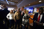 Former Secretary of State Mike Pompeo, center, poses for a photo with audience members after speaking at the West Side Conservative Club, Friday, March 26, 2021, in Urbandale, Iowa. (AP Photo/Charlie Neibergall)